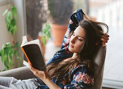 woman-reading-a-book-on-the-weekend-jmYm